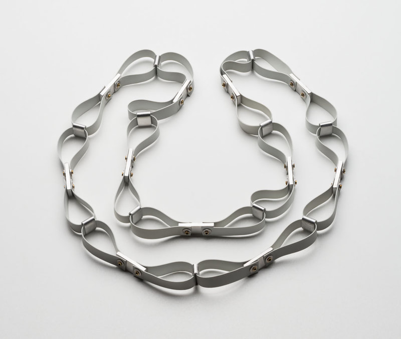 Loops, 2019, aluminium, brass, rubber